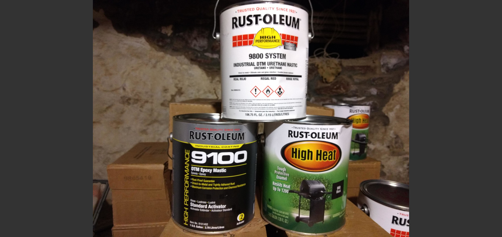 3 gallon cans of Rustoleum paint stacked