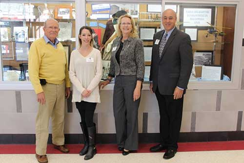photo of Pete Choate, Justine Musick, Virginia Brooke and Ralph Ciaudelli in front of Hallowell Exhibit