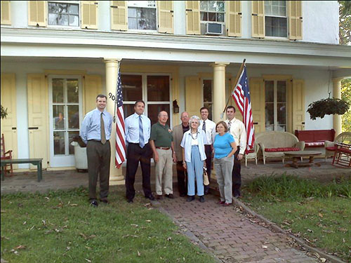 photo of Horsham Township Council with Pete and Margaret Choate in the foyer of the Penrose Strawbridge House