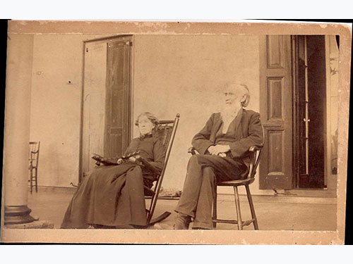 photo of Abel and Sara Penrose c1875-1893? on rocking chairs on porch
