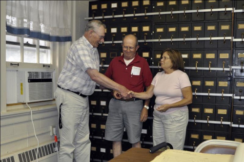 photo of Hatboro Borough Historian Dave Shannon receiving donation from HPHAs Pete and Margaret Choate