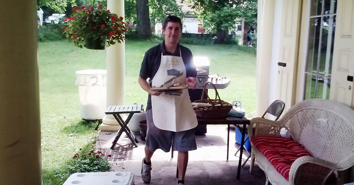 photo of Sam Jadczak cooking at Summer Corn Boil