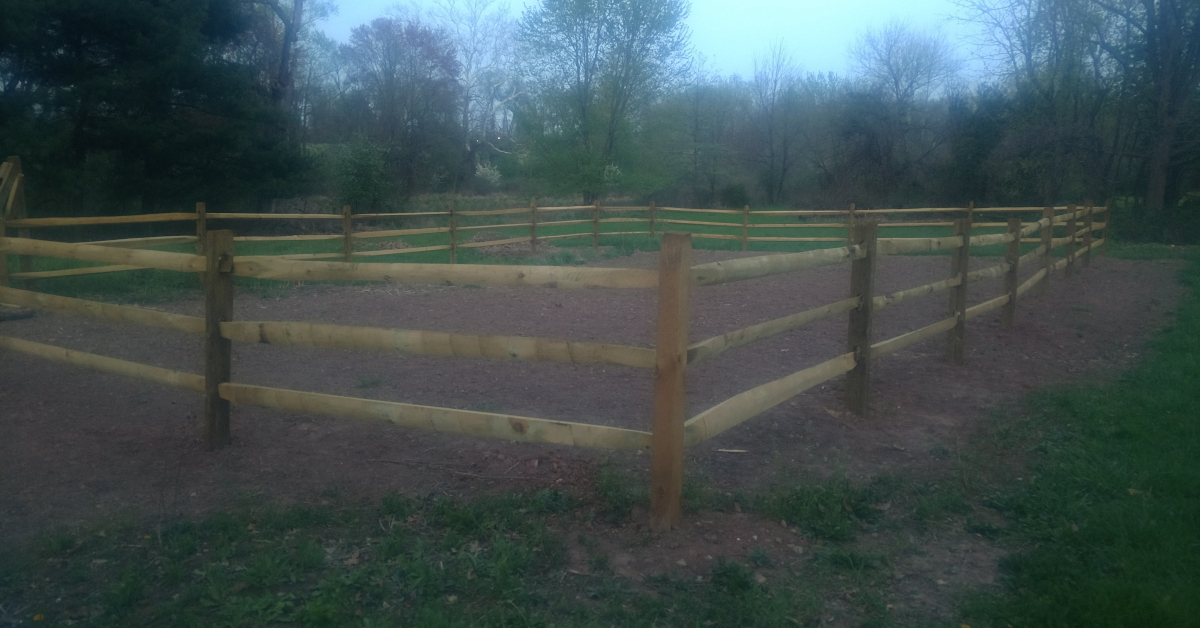 photo of split rail fence around empty garden
