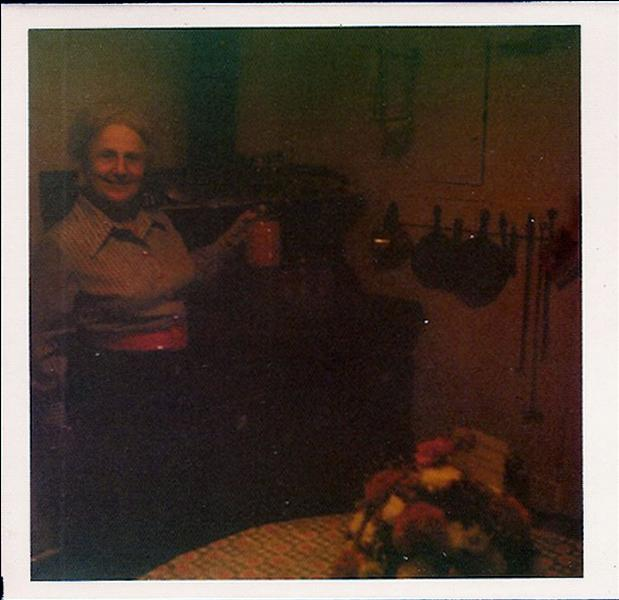 photo Margaret Strawbridge sin front of the coal stove in the kitchen of the Penrose Strawbridge House