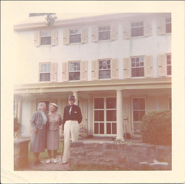photo of Margaret and Welsh Strawbridge with Clair Taylor in front of the Penrose Strawbridge House